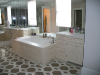 honed-calacatta-gold-marble-master-vanity-and-tubdeck